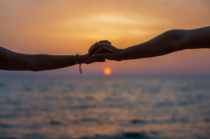 Greece Destination Engagement - Corfu - holding hands with sunset background