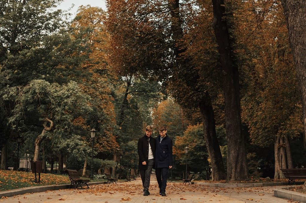 Gay couple walking in a park