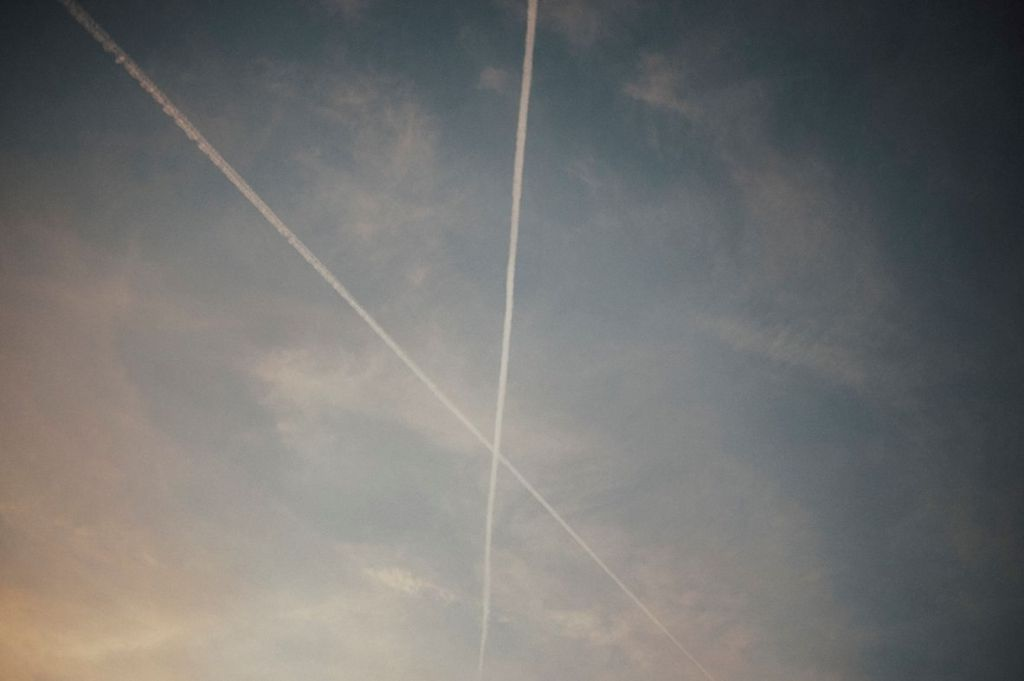 two airplane trails intersecting