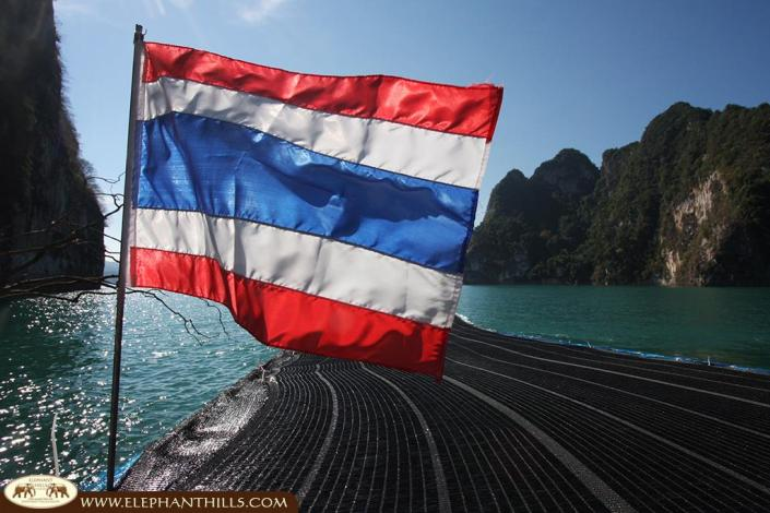 The flag of the Kingdom of Thailand, showcasing 3 different colors with different meanings: red for the land and people, white for religions and blue for the monarchy