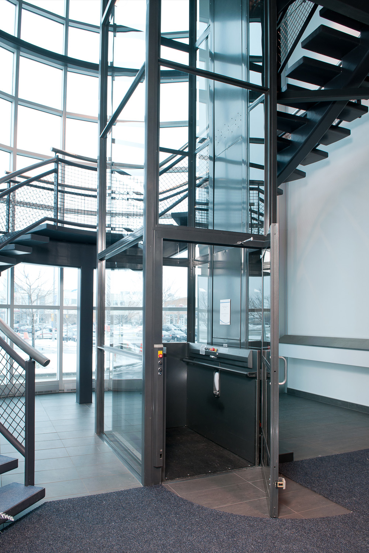 Glass Vertical Wheelchair Lift