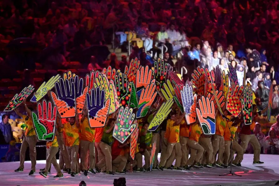 RIO DE JANEIRO, BRAZIL - AUGUST 21: Voluneers participate during the Recognition of the Volunteers segment during the Closing Ceremony on Day 16 of the Rio 2016 Olympic Games at Maracana Stadium on August 21, 2016 in Rio de Janeiro, Brazil. (Photo by David Ramos/Getty Images)