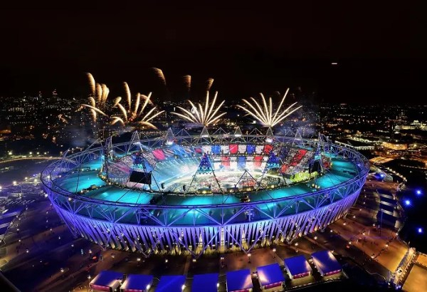 LONDON, ENGLAND - JULY 27:  Fireworks ignite over the Olympic Stadium during the Opening Ceremony for the London 2012 Olympic Games on July 27, 2012 at Olympic Park in London, England.  (Photo by Jamie Squire/Getty Images)