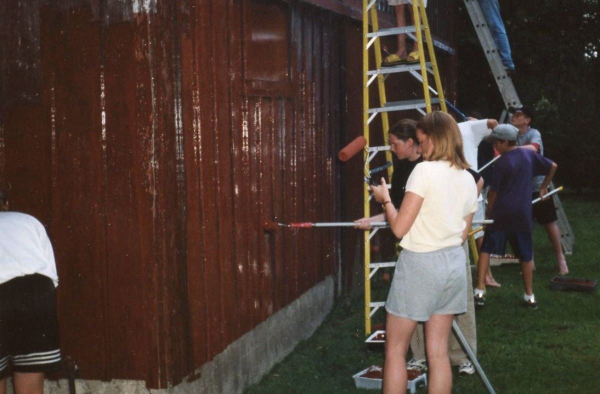 Church Group of Barry Lees painting the Paynes Mills barn in 2000.
