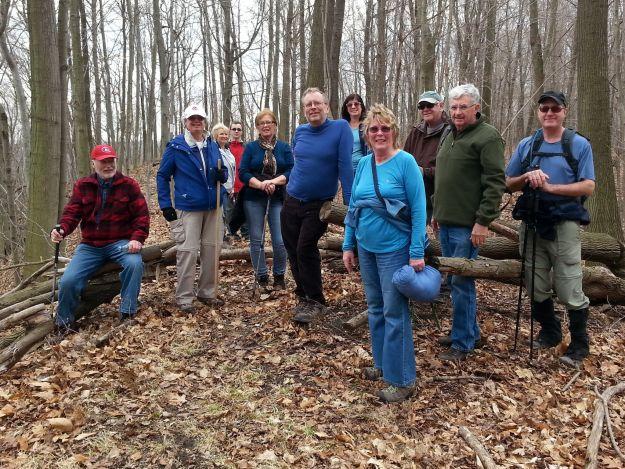 Dozen hikers enjoying spring like weather in winter.