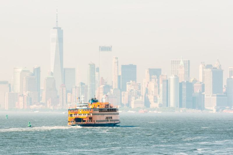 Staten Island Ferry and Lower Manhattan Skyline, New York City, USA.