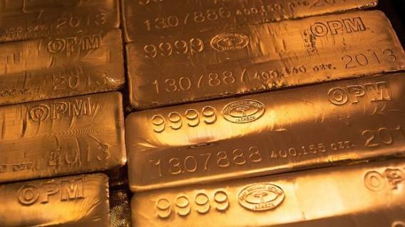 Oro toca máximo de una semana por debilidad del dólar, expectativas sobre tasas Fed