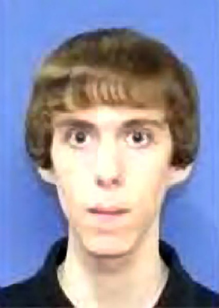 "The shooter appears to have a blank, mindless expression. He looks like a mindless drone, however his eyes are open and does appear to be ""awake""."