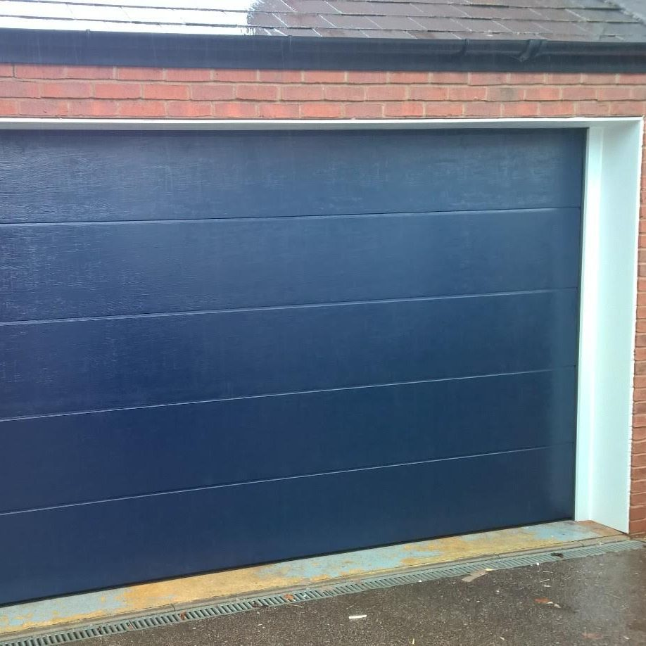 Novoferm iso 45 Sectional Flush Garage Door in Steel Blue Woodgrain Finish  Elite GD