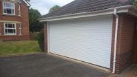 Conversion from two single doors to one double garage door ...