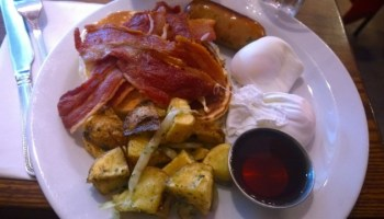 The All American Breakfast Club review. Pancakes, eggs, sausage, home-style fried potatoes, streaky bacon and maple syrup