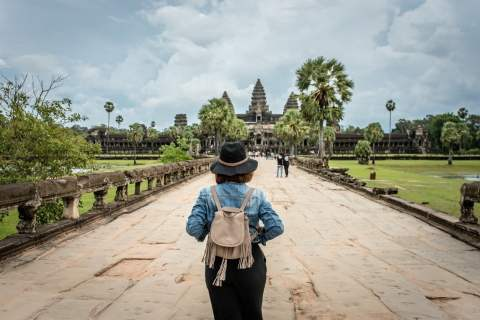 Women tourists wear jacket jeans walking into Angkor Wat landmark in Siem Reap, Cambodia. Angkor Wat inscribed on the UNESCO World Heritage List in 1992