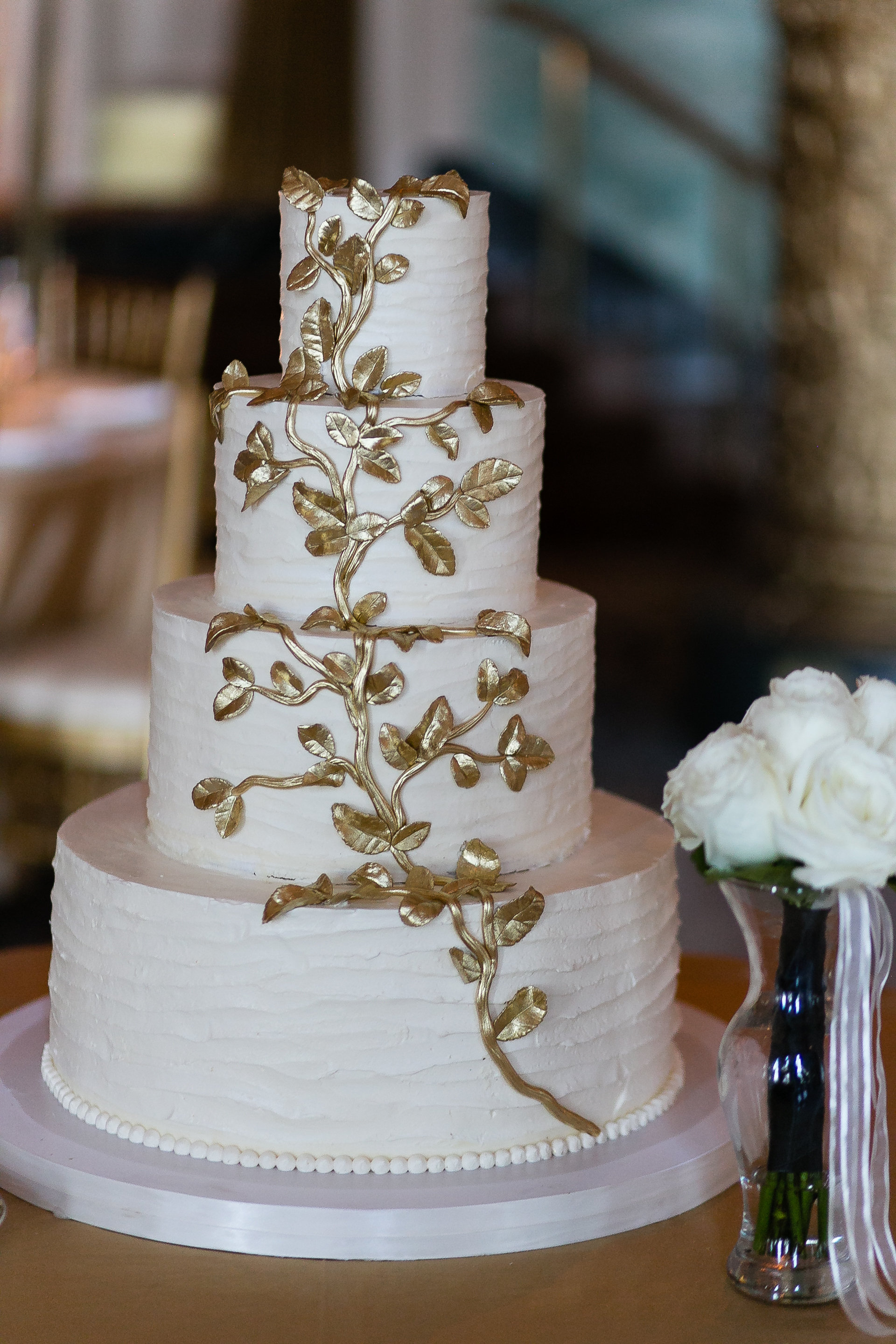 White Wedding Cake With Gold Leaf