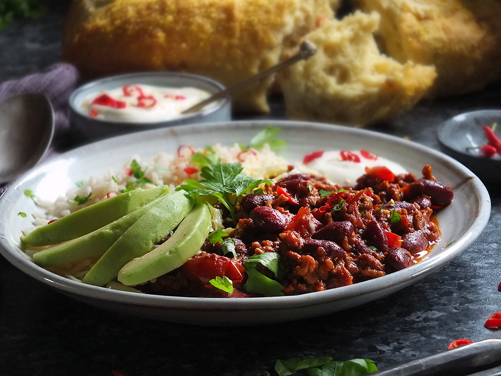 This super easy Chilli con Carne recipe is made with lamb mince, which lends a delicious earthy flavour to the classic dish. Serve with rice, soured cream and slices of creamy avocado - perfect for a midweek meal.