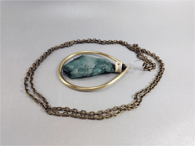 Boho pendant made with brass, emerald, silver and natural beads, by Elizart