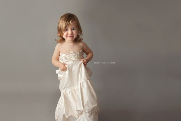 toddler wearing mommy's wedding dress