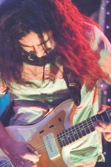 Eduardo Gutierrez in a trance-like mood playing the guitar. | photo by Emilyo Arias