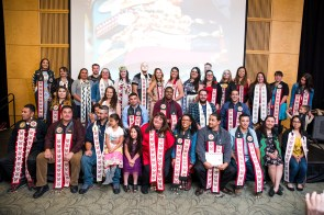 ITEPP graduating class of 2017 posing with family while wearing their sashes after their commencement ceremony. Photo by Kellie Jo Brown