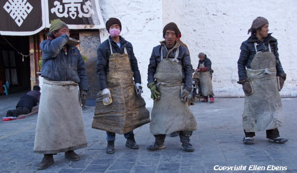 Barkhor Street, Lhasa: a group of men prostrating around the Jokhang Temple