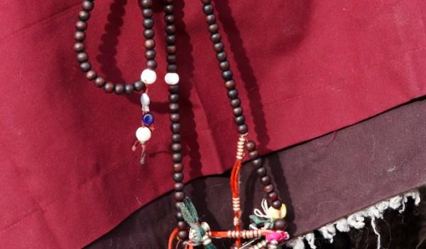 Lhasa: pilgrim holding a mala