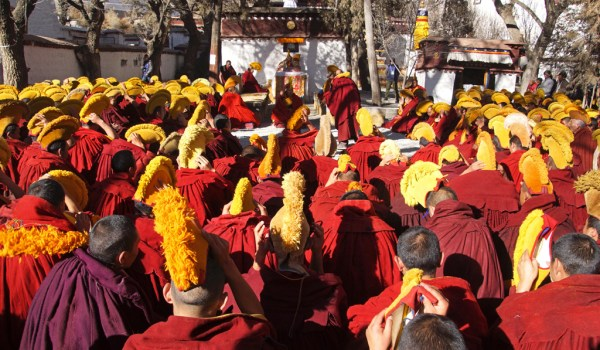 Special ceremony at Sera Monastery, Lhasa: at the end of the ceremony the monks put on their yellow hats