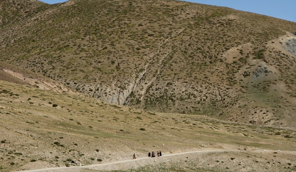 Pilgrims returning to Darchen after walking the kora around Mount Kailash (2010)