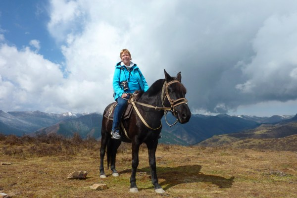 Riding horse in the mountains near Songpan, October 2016
