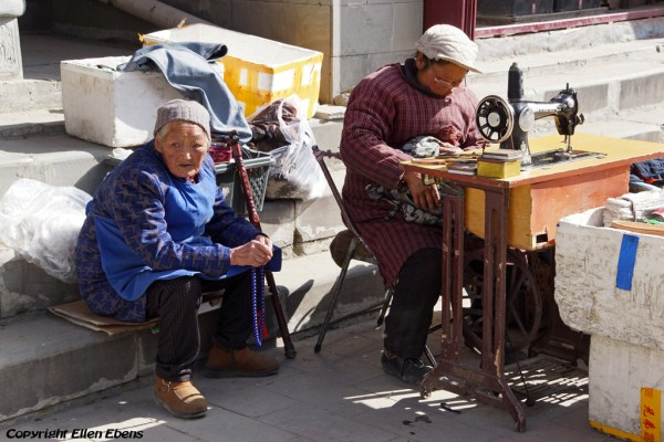 Needlewoman at work in the streets of Songpan Ancient Town