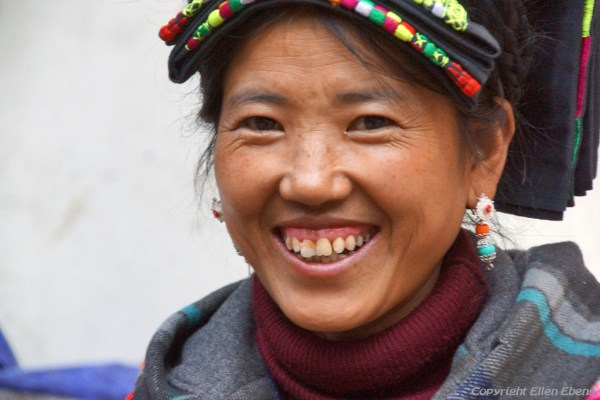 Smiling lady in traditional clothes at the town of Ma'erkhang (Barkham)