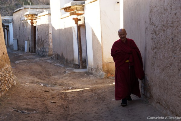 Monk walking the street at Labang Monastery, Xiahe