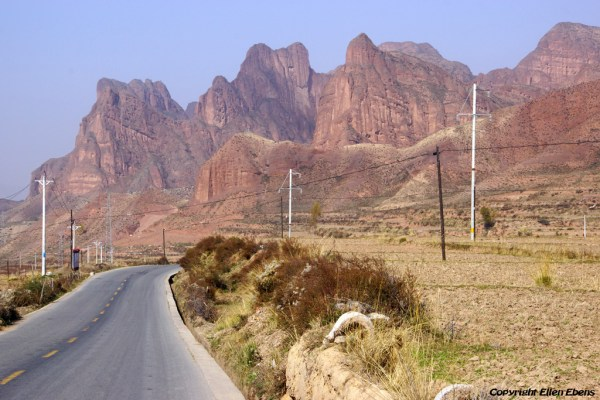 Landscape on the way from Xiahe to Rebkong (Tongren): red coloured mountains near the village of Shuangpengxi