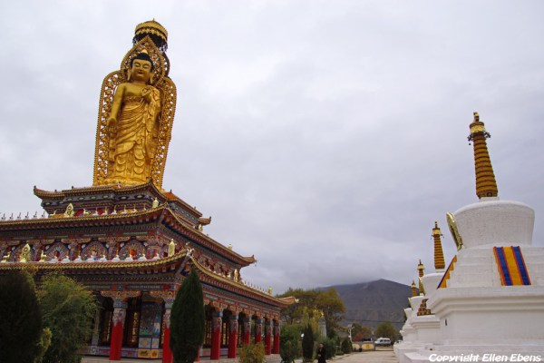 Buddha statue with stupas at Wutun Monastery at Rebkong (Tongren)