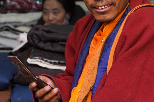 Lhasa, monk resting in a small shop at Barkhor Street