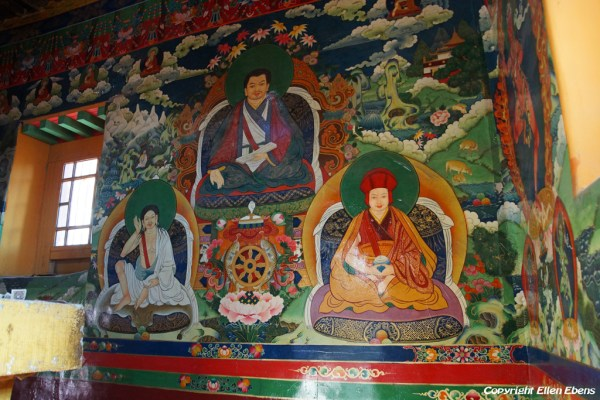 Murals inside the watchtower of Densatil Monastery, in the centre is a stupa.