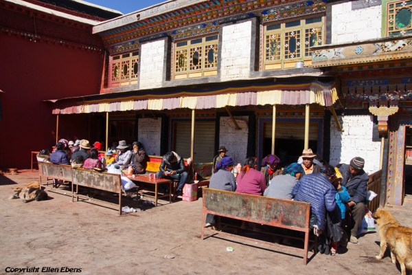 Pilgrims relaxing, eating and drinking at the restaurant of Shalu Monastery
