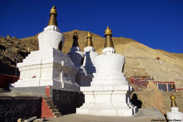 Walking the kora at Sakya and passing the stupas