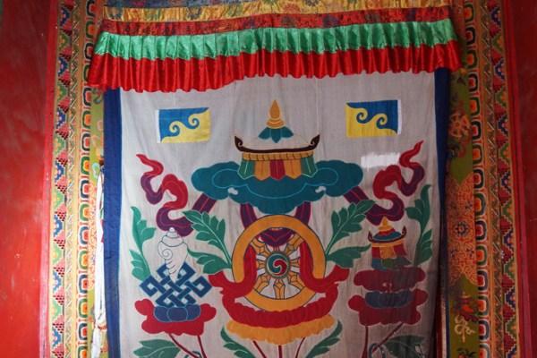 Entrance to a hall at Tsurphu Monastery