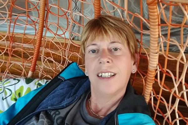 Me at the balcony of my hotel room at Lugu Lake