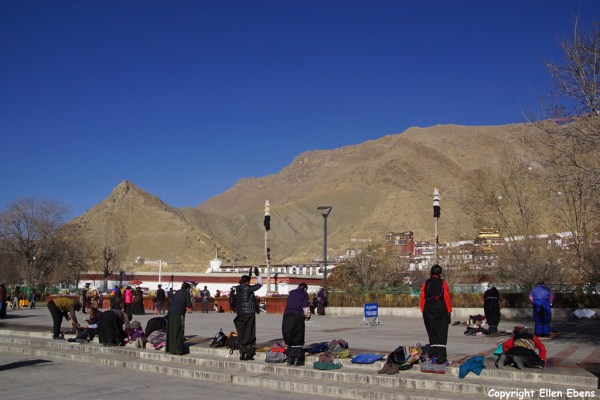 Pilgrims prostrating at the square in front Tashilhunpo Monastery, Shigatse