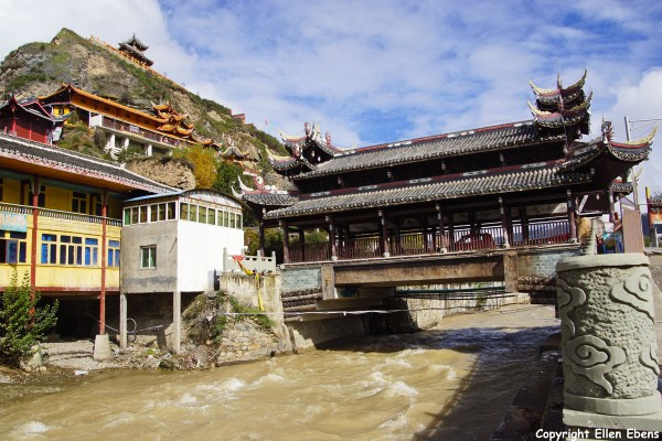 Songpan, an old covered bridge over the Ming river