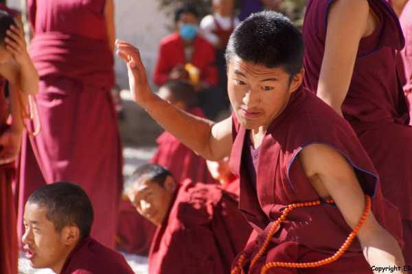 Lhasa, monks debating at the debating court yard of Sera Monastery.