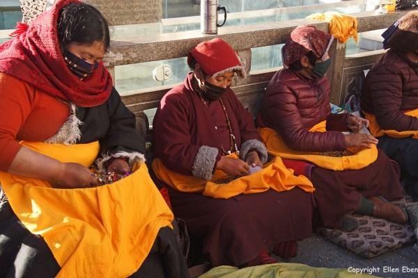 Lhasa, mandala praying pilgrims in front of the Jokhang Temple
