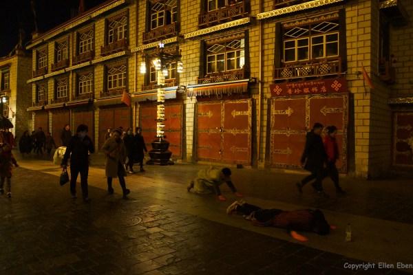 Lhasa, pilgrims walking and prostrating at Barkhor Street