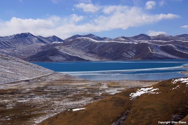 Driving over a high pass to Yamdrok Tso Lake