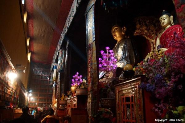 Statues inside Tsurphu Monastery