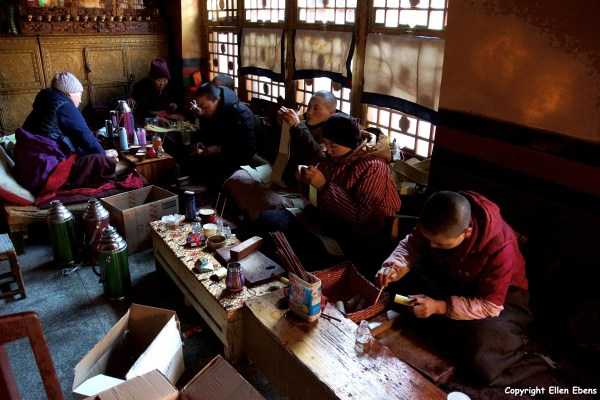 Nuns rolling up holy scriptures at the Ani Tsankhung Nunnery
