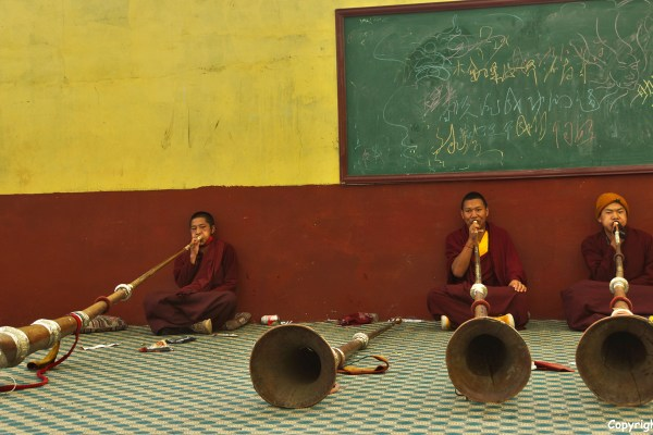 Nangchen monastery monks long horns