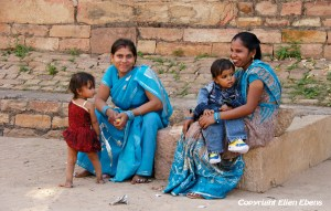 Two women with their young kids visiting the fort of Gwalior