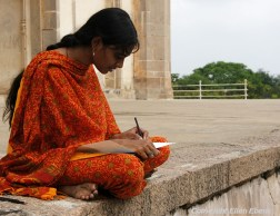Woman drawing at the Qutb Shahi Tombs near Hyderabad