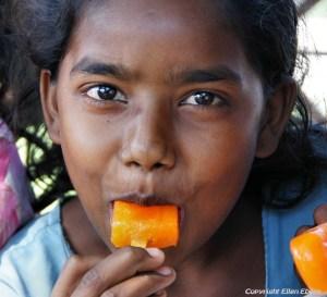 Girl enjoying an ice cream at the city of Bijapur
